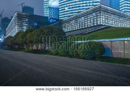 modern illuminated office block buildings in downtown,china.