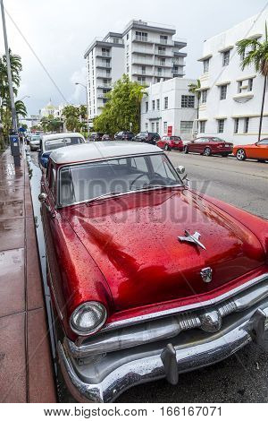 The Art Deco District In Miami And A Classic Ford Car