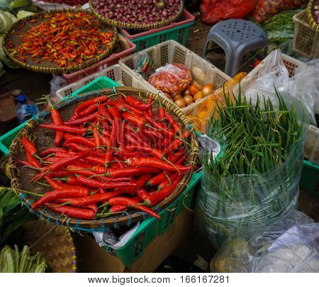 Green grocer sells various kind of vegetables at traditional market in Jakarta Indonesia java