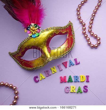 Colorful mardi gras or carnivale mask on a purple background. Venetian masks.