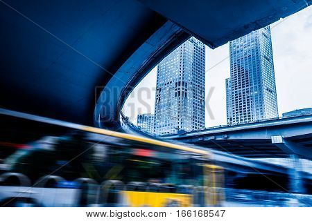 Traffic On Road Under Overpass in Shanghai China.