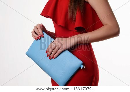 Fashionable Woman With A Blue Bag And Red Evening Dress