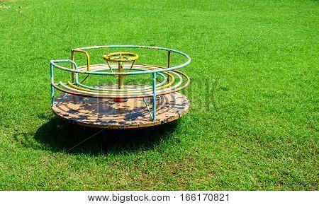 merry-go-round in the garden for children on grass