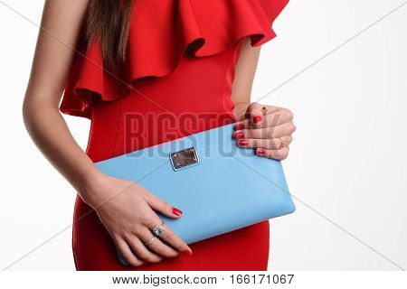 Close Up Fashion Woman In Red Dress With Blue Handbag