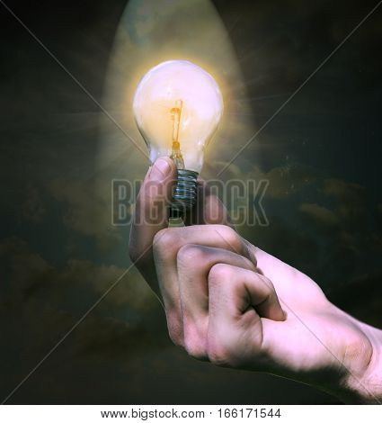 Men hand in bulb the background of sky