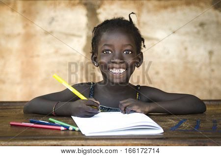 Education Symbol: Big Toothy Smile on African School Girl