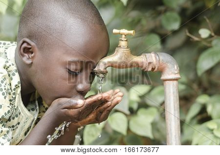 Little black boy asking begging for clean water. Its scarcity affects every continent. Around 1 billion people live in areas of physical scarcity and many more people approach this situation.