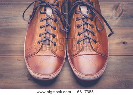 A pair of brown leather shoes with vintage.