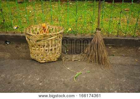 Broom stick and trash basket made from bamboo photo taken in jakarta indonesia java