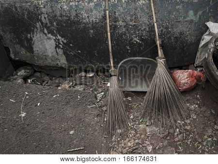 Two bamboo broom stick and a scoop lay down on the ground photo taken in Jakarta Indonesia java