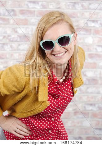 beautiful young blonde woman with a yellow jacket