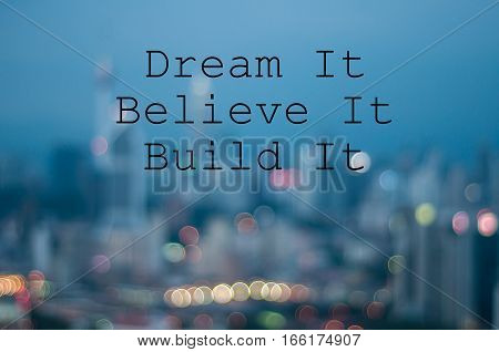 DREAM IT BELIEVE IT BUILD IT on blur city background