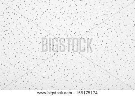 A porous soundproof ceiling tile texture, background