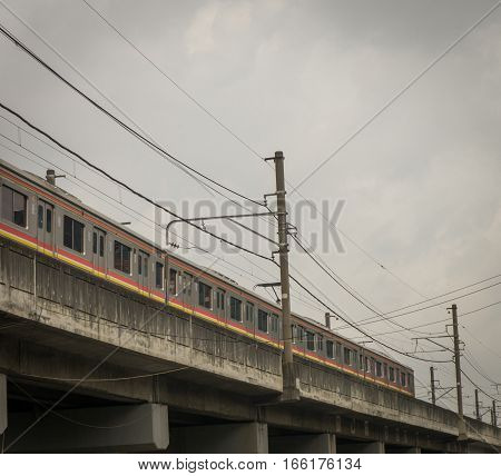 a commuter line passing trough an overpass photo taken in Jakarta Indonesia java
