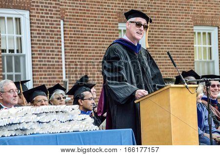 Charlottesville, USA - May 18, 2014: Professors listening to speaker at graduation ceremony at University of Virginia