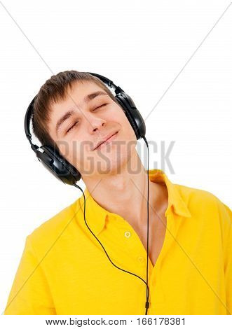 Young Man in Headphones listen to the Music Isolated on the White Background