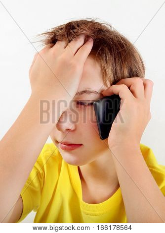 Sad Kid with Cellphone on the White Background