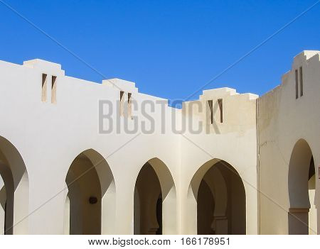 Closeup of arabic architectural detail arches against sky
