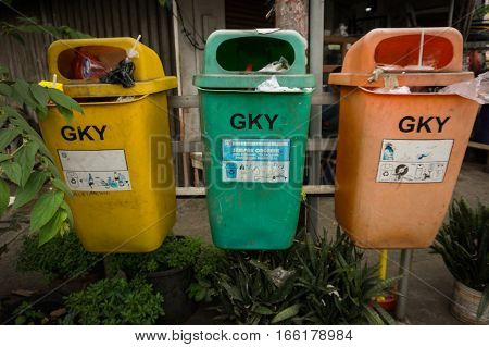 Three colorful trash bin with different function photo taken in Jakarta Indonesia java