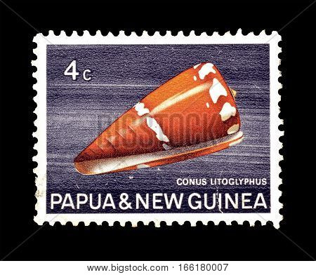 PAPUA NEW GUINEA - CIRCA 1969 : Cancelled postage stamp printed by Papua New Guinea, that shows Pebble Carved Cone.