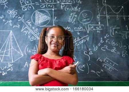 Portrait Happy Girl Resolving Complex Math Problem On Blackboard