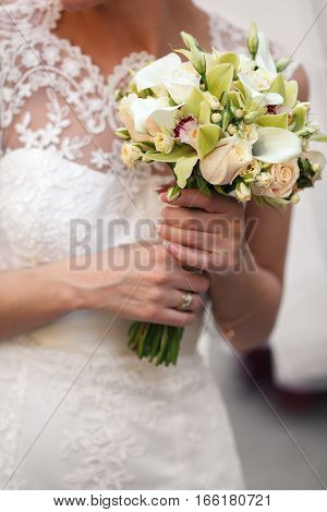 Tender Woman's Hands Hold A Bouquet Of Callas And Pink Roses