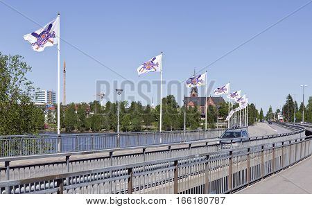 UMEA, SWEDEN ON MAY 29. View of a bridge across the river. Banners, flags for the festival, Rounders Cup on May 29, 2013 in Umea, Sweden. Summer and sunshine. Editorial use.