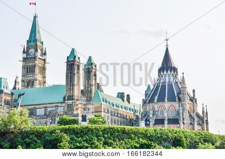 Ottawa, Canada - July 24, 2014: Canadian parliament hill building with flags