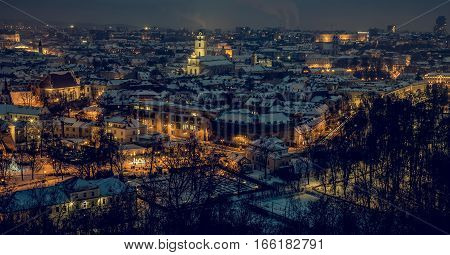 Night panorama of the Vilnius Old Town from the Hill of Three Crosses. Vilnius winter aerial panorama of Old town. Aerial panorama of the Vilnius Old Town at dusk time. Vilnius old town panorama.