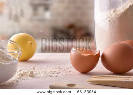 Fresh Eggs And Lemon With Utensils On Wooden Bench Front