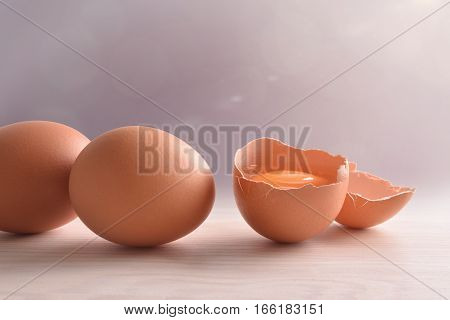 Fresh Eggs On Wooden Bench With Gray Background And Light