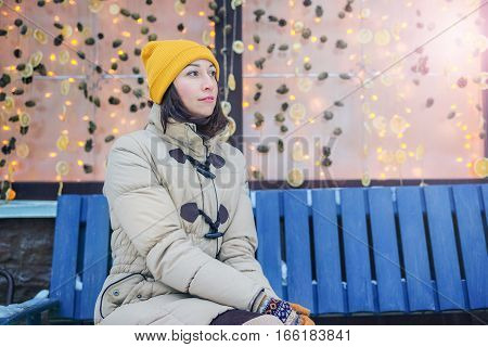 Girl Sitting On A Bench Outside