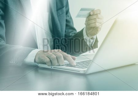 Man Using Computer With A Credit Card To Shopping Online.