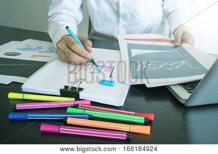 Man Writing Graph On Paper With Color Pen.