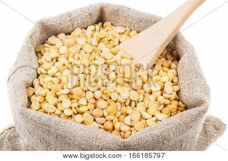 Wooden Spoon In Dried Peas In Sackcloth Bag On White
