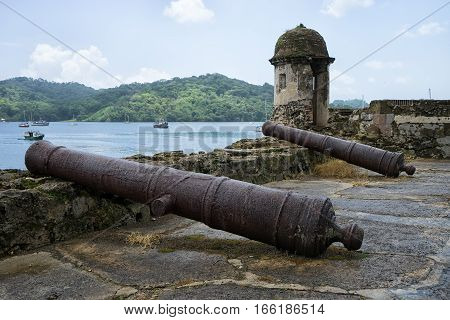 June 12, 2016 Portobelo, Panama: vintage cast iron cannons at an old Spanish fort ruins