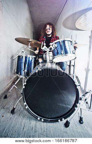 Drums conceptual image. Drummer play on drumset. Retro vintage instagram picture.