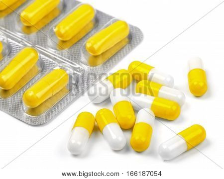 useful yellow pills on a white background