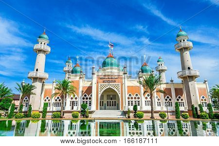 Central Mosque of Pattani with reflection and bright blue sky Southern Thailand