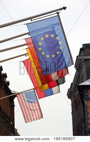 flags of different countries hung on the building