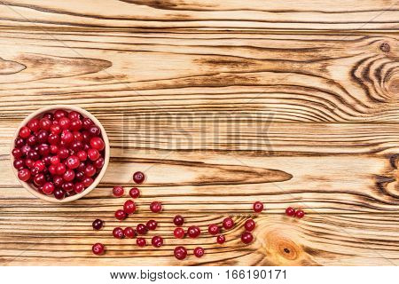 Cranberry. Cranberries On Glay Plate Wooden Background