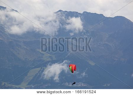 Paraglider flying his wing in the French Alps