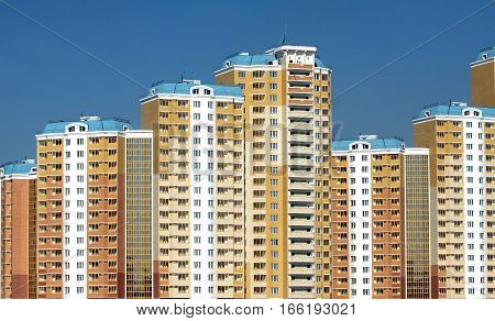 New district with constructed buildings over clear cloudless blue sky closeup