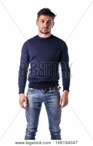 Handsome young man with blue pullover in studio shot, standing