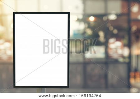 Blank mock up of vertical poster billboard sign with copy space for your text message or content in modern shopping mall.