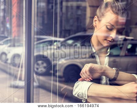 Beautiful lonely woman sitting in front of window.