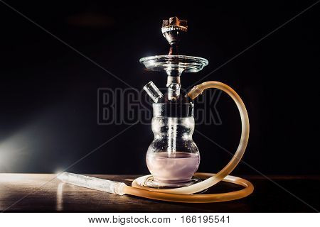glass hookah close on a table on a black background
