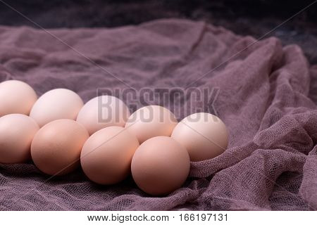 Brown eggs on napkin. Farmers food concept.