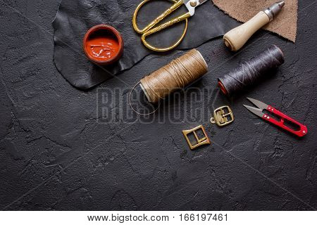 leather craft instruments on dark background top view mock up.