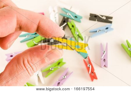 Photo picture of multicolored clothespin background texture